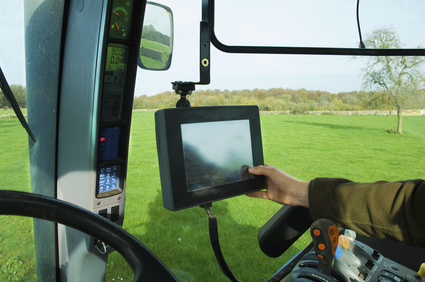 Touch screen used in agricultural vehicle